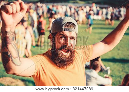Man Bearded Hipster In Front Of Crowd. Open Air Concert. Fan Zone. Music Festival. Entertainment Con