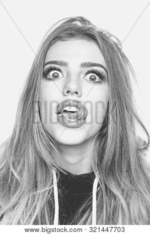 Portrait Of A Funny Hipster Girl Looking At Camera Over White Background. Comic Woman. Close Up Port