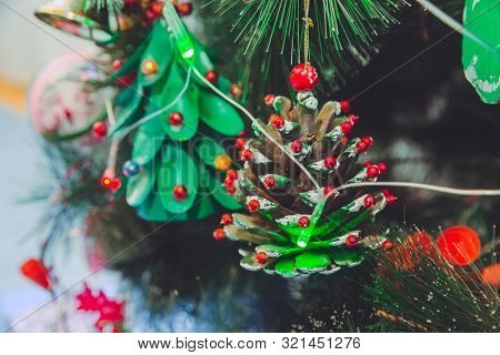 Christmas Decoration In The Form Of A Fallen Pinecone, In The Blue Background, Branches Christmas Tr