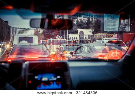 Looking Behind The Cars.cars Are Red, Yellow Night Light. Traffic Jams In The City With Row Of Cars