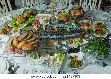 Cooked Fish Is On The Table .grilled Sturgeon Fish. Grilled Sturgeon Fish. Healthy Food.bread, Sausa