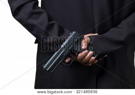 Businessman Holding A Pistol Gun. Concept Picture Of Assassin Or Smart Bodyguard.