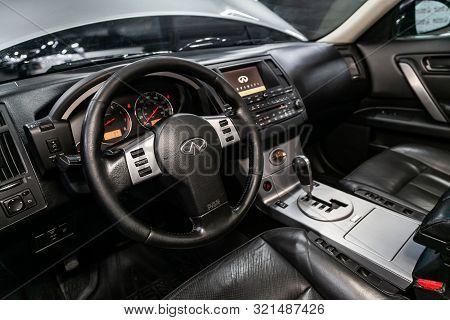Novosibirsk, Russia - August 24, 2019:  Infiniti Fx,  Black Luxury Car Interior - Steering Wheel, Sh