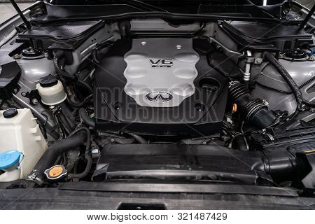 Novosibirsk, Russia - August 24, 2019:  Infiniti Fx,  Close Up Detail Of  Car Engine, Front View. In