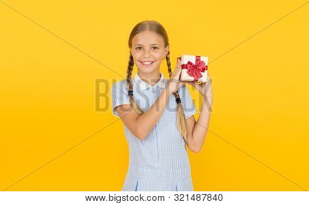 Generosity Concept. Holiday Celebration. Girl Received Gift. Tidy Adorable Pupil Open Gift Box. Educ