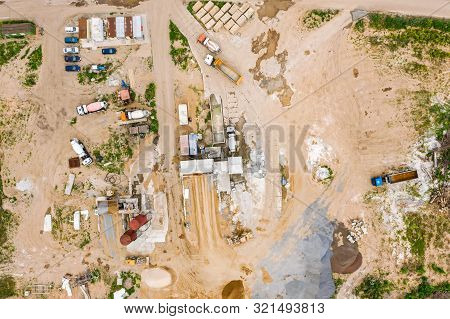 Industrial Concrete Batching Plant On Construction Site. Trucks Loading At Concrete Mixing Factory.