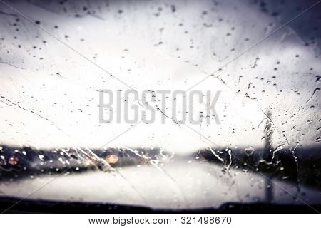 Water drops on windshield during a rainstorm