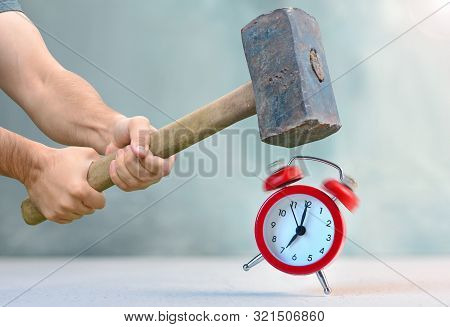 Early Awakening With Ringing Alarm Clock. Man With Big Hammer Going To Destroy Morning Alarm Clock.