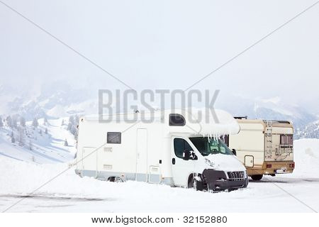 Snowed motorhomes at winter mountains