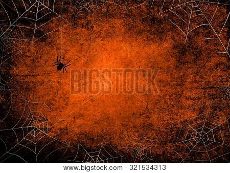 Halloween Orange And Black Grunge Background With Silhouettes Of Spiders And Spider Webs On Dark Spo