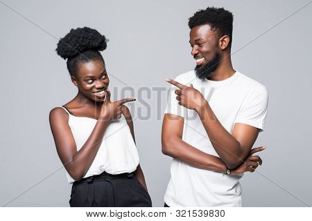 Blaming Each Other. Beautiful Young African Couple Pointing Each Other While Standing Isolated On Wh