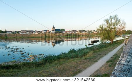 Horizontal View Of The Smalltown Of Jargeau In The French Countryside On The Loire River With Riverb