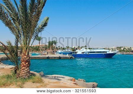 Hurghada / Egypt. 30 July 2018:  View Of Embankment Of Hurghada With Moored Yachts, Ships And Beauti