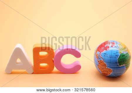 Abc First Letter Of The English Alphabet And Small Globe . Empty Space For Text. Learning Foreign La