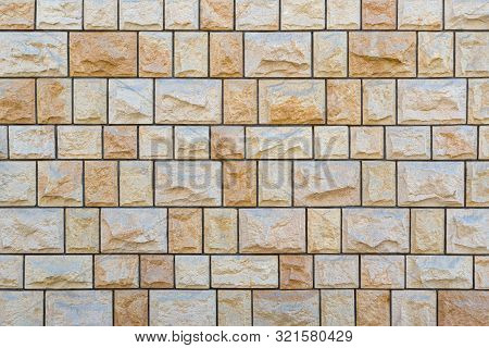 Bright Stone Wall Of Exactly Square Rough Natural Stones And Dark Joints