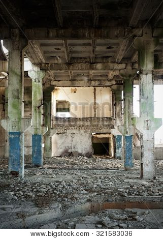 Abandoned And Ruined Factory Building With Painted Columns