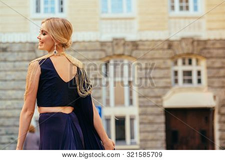 Outdoor Portrait European Blond Woman With Blue Eyes With Bright Make Up Wearing Elegant National Tr
