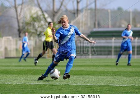 KAPOSVAR, HUNGARY - APRIL 20: Unidentified players in action at Hungarian Cup Final women soccer game  MTK (blue) vs. Viktoria FC (white) April 20, 2011 in Kaposvar, Hungary.