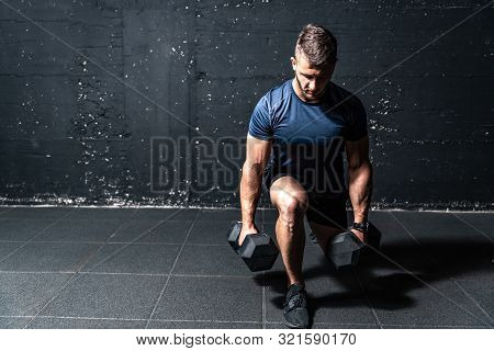 Dumbbells Weight Training, Young Strong Fit Muscular Sweaty Man With Big Muscles Strength Cross Work