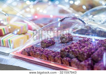 Traditional Turkish Delight Rahat Lokum And Other Oriental Sweets In Market. Traditional Purple Turk
