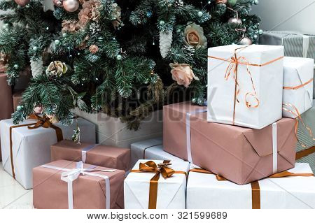 Christmas Gifts Under The Christmas Tree Close-up. Concept New Year And Christmas 2020. Postcard. Ch