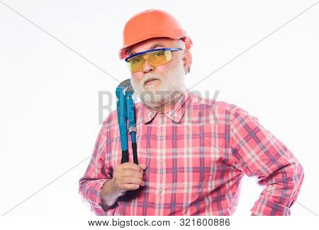 Plumber Service. Man Bearded Plumber Wear Helmet And Hold Wrench Tool. Repair Concept. Sanitary Engi