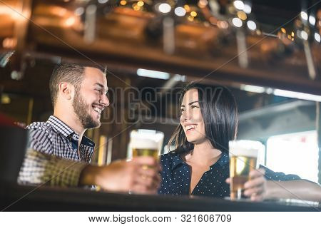 Young Couple At Beginnings Of Love Story - Pretty Woman Drinking Beer With Handsome Man At Pub - Rel