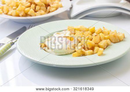 Homemade Fried Egg With Potato On Elegant Dish