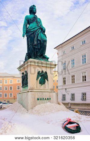 Mozart Monument On Mozartplatz Square At Old City Of Salzburg