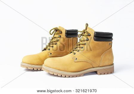Yellow Men's Work Boots From Natural Nubuck Leather Isolated On White Background. Trendy Casual Shoe