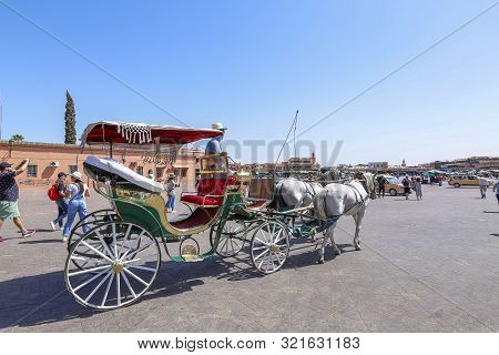 Carriage And Tourists In Jamaa El Fna Square