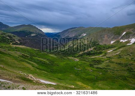 Rocky Mountains panoramic view with rain on the background
