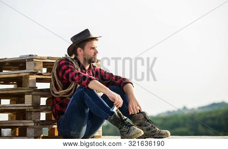 Watching Sunset. Farmer Cowboy Handsome Man Relaxing After Hard Working Day At Ranch. Romanticism Of