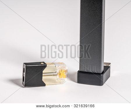 Morgantown, Wv - 11 September 2019: Juul E-cigarette And Nicotine Vaping Juulpod On White Background