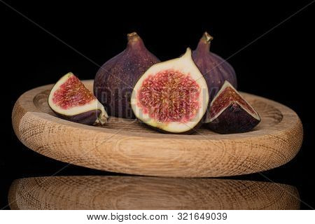 Group Of Two Whole One Half Two Slices Of Meaty Fresh Fig Fruit On Bamboo Plate Isolated On Black Gl