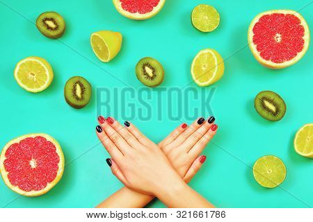 Trendy Red And Blue Manicure On Mint Background With Fresh Fruits. Flat Lay Style.