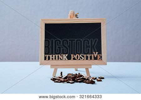 Positive Attitude, Happy And Optimistic Thinking Concept. The Inscription Think Positive On The Blac