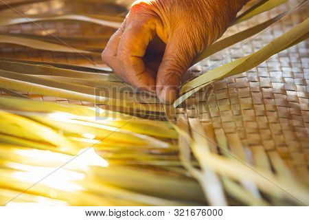 Hand and woven mat, wilt old hand, traditional Thai mat making,Hand made work poster