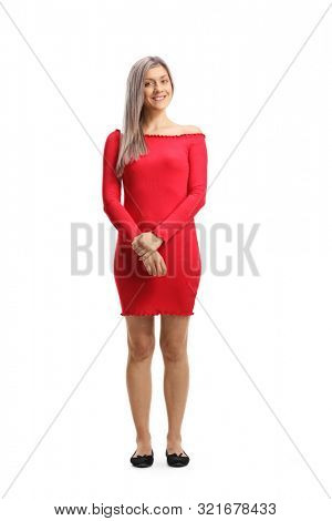 Full length portrait of a young blond woman posi in a red dress isolated on white background