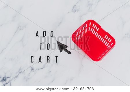 Add To Cart Concept, Message On Desk With Shopping Basket And Mouse Pointer Icon Next To It