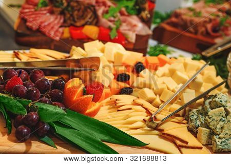 Cheese Platter And Mixed Fruit Made To Suit Whichever Occasion As Catering Table. Different Varietie