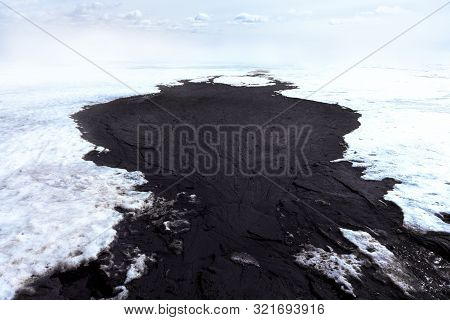 Dirty Oil Stains On The Surface Of The Lake Water Polluted As A Result Of Run-off Of Waste Industria