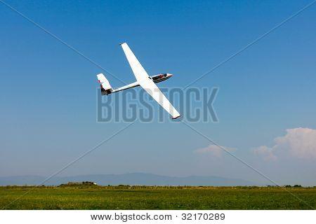 Glider Flying On A Blue Sky