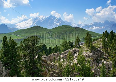 Beautiful Mountain Scenery With Green Hills And Marmolada Peak On The Horizon -  Dolomites Italy.
