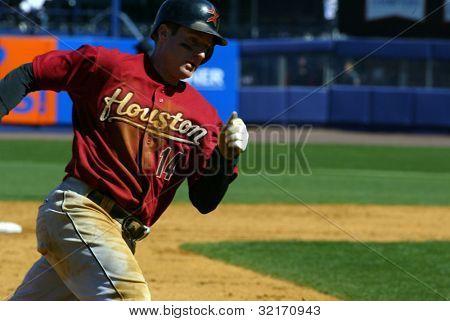 NEW YORK - APRIL 11: Morgan Ensberg #14 of the Houston Astros runs around third base at Shea Stadium April 11, 2005 in Flushing, New York