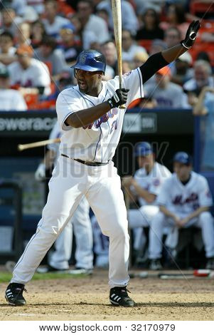 NEW YORK - MAY 20: Carlos Delgado #21 of the New York Mets gestures as he prepares to hit against the New York Yankees on May 20, 2006 at Shea Stadium in Flushing, New York.