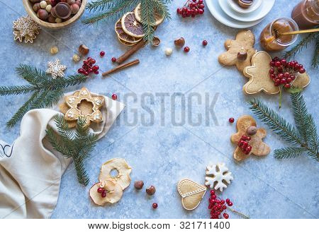New Year 2020 And Christmas Background. Christmas Candy Cane Gingerbread On Blue Background. New Yea