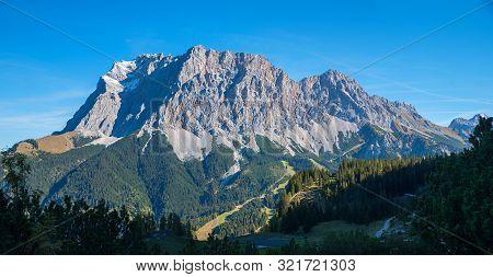 Famous Zugspitze Mass, Seen From The Austrian Side, Near Ehrwald. Landscape Tirol.