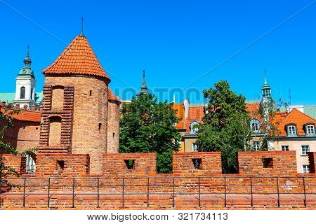 Warsaw, Poland Barbican Or Barbakan Fortified Xvi Century Outpost With The Defense Walls In Historic