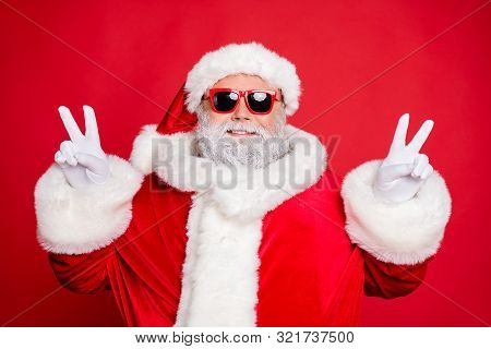 Close-up Portrait Of His He Nice Attractive Cheerful Cheery Peaceful Bearded Santa Showing Double V-
